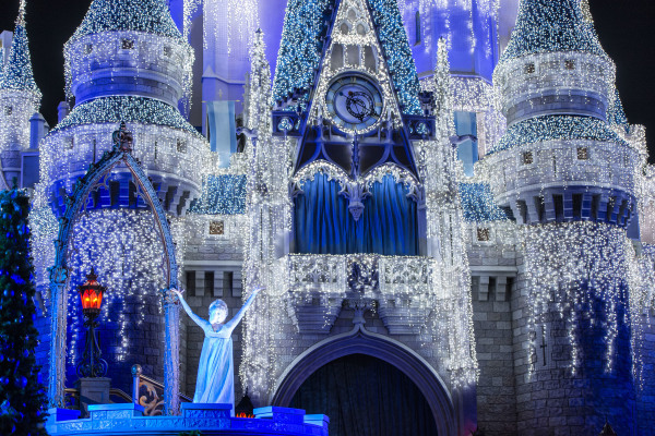 "Queen Elsa from ÒFrozenÓ Transforms Cinderella Castle in ""A Frozen Holiday Wish"""